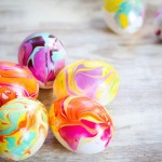 Easter egg coloring with nail polish.