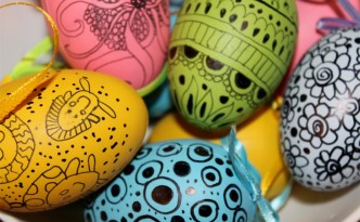 Easter eggs painted with crayon, marker, wax crayons, paints
